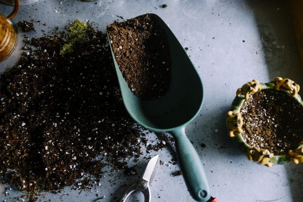 garden soil, pots and shovel